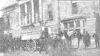 Newspaper photo of strike-breaking truck escorted by police and followed by strikers, St. Patrick's Quay, Cork