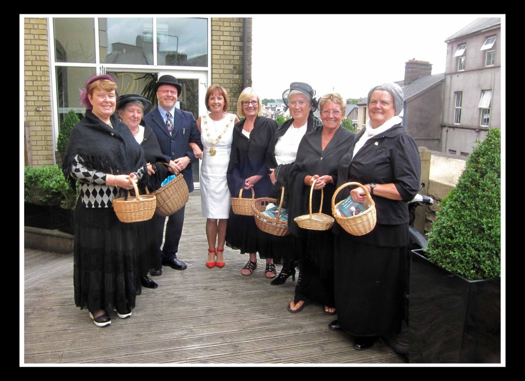 Lord Mayor Catherine Clancy (centre) with Richard T. Cooke and local women at the Maldron.