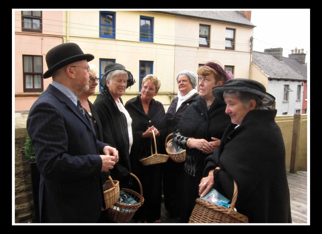 Richard T. Cooke with local women in period dress at the Maldron Hotel, Shandon.