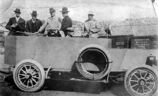 """Armed agents of the Baldwin-Felts detective agency in their """"Death Special"""" armoured car"""