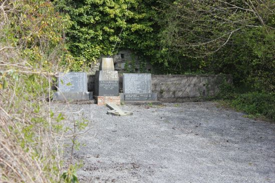 """Inaccessible Magdalene burial plot, Sunday's Well Cork.   Plaque beneath broken cross reads: """"A memorial to the Residents of St. Mary's Good Shepherd Convent, Sunday's Well. 1873-1993"""""""