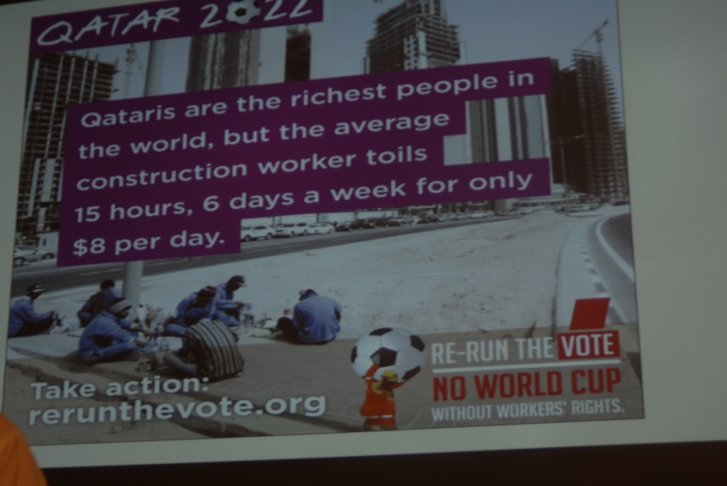 Slide showing the stark situation of migrant workers in Qatar building stadiums for World Cup 2022.