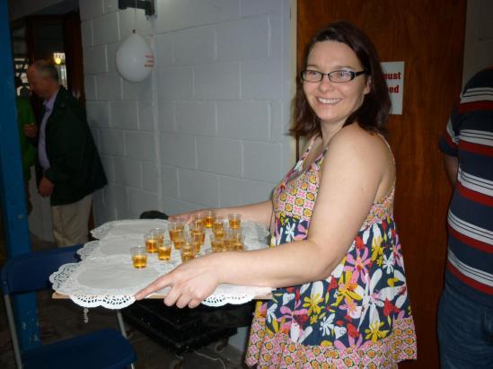 Ailbhe Mahony, member of the Cork Mother Jones Committee distributing shots of Irish whiskey for the toast to Mother Jones on Mother Jones Day.