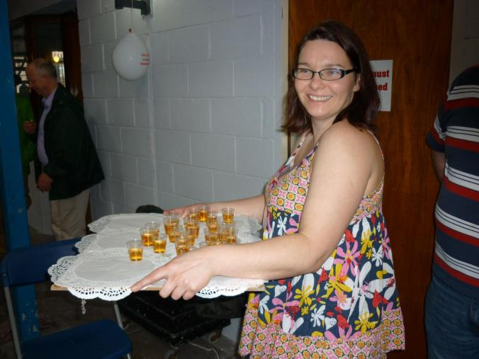 Ailbhe Mahony, member of the Cork Mother Jones Committee distributing shots of Irish whiskey for the toast to Mother Jones on Mother Jones Day.